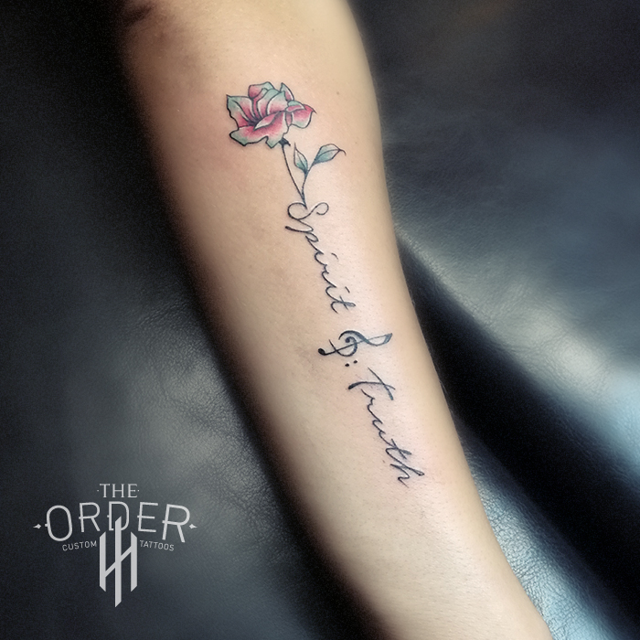 Small Flower And Writing Tattoo – The Order